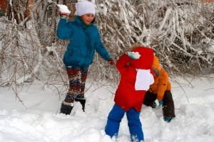 kids playing in the snow on their glamping holidays