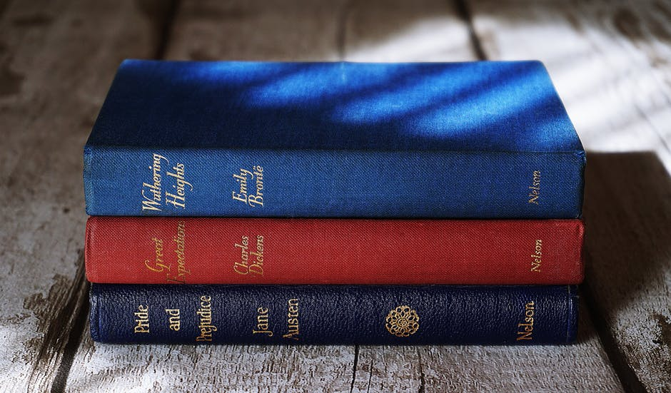 A pile of books, the bottom one being Jane Austen's Pride and Prejudice