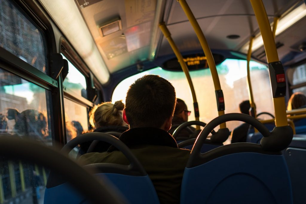 A man sitting on a bus