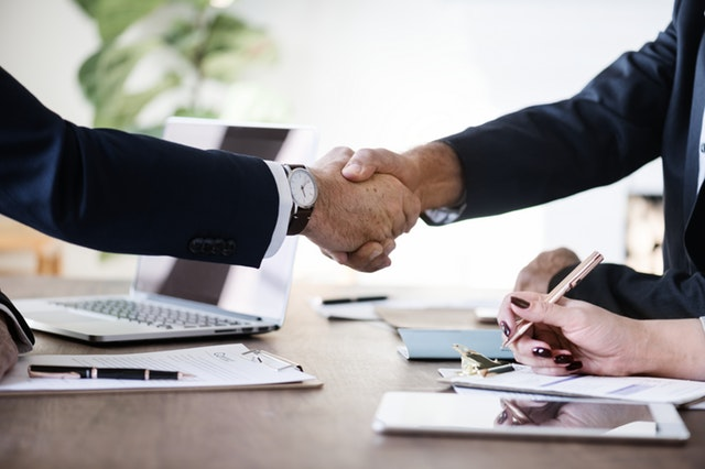 A handshake in a business meeting.