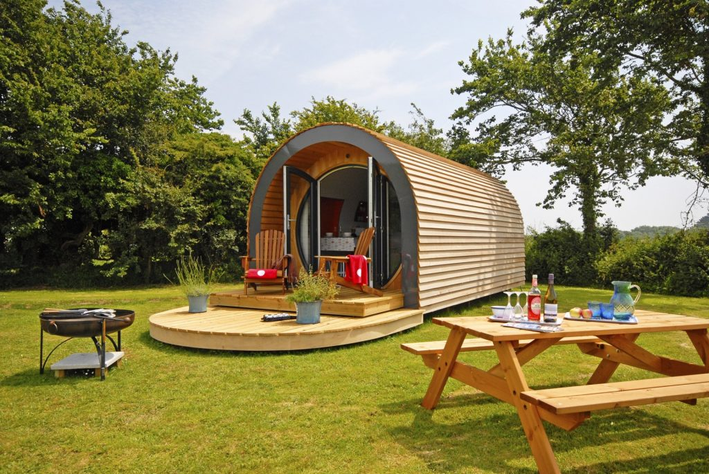 One of our eco pods in the heart of the British countryside on a sunny day.